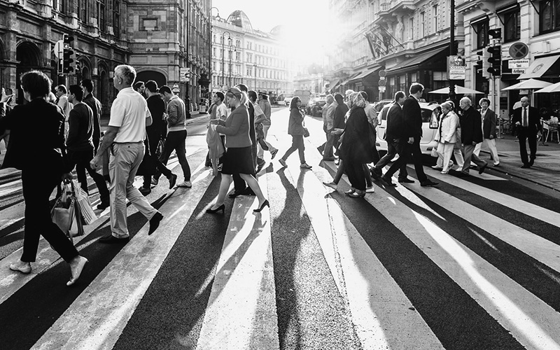 decorative image of people crossing the road
